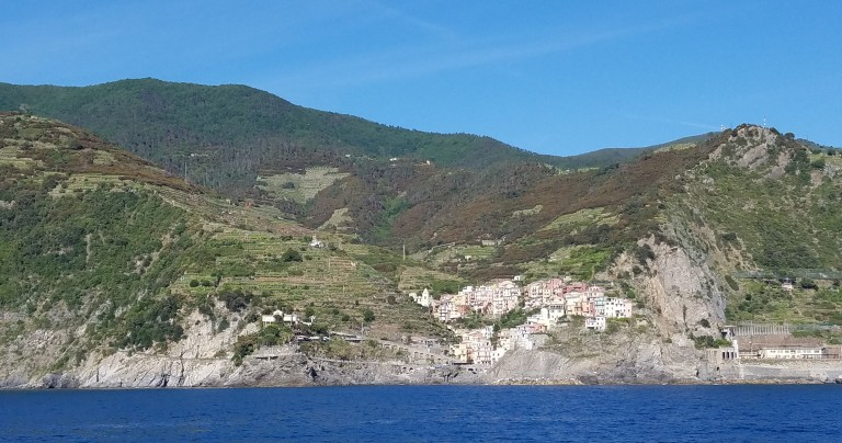 Italy Travel Tip | Take a boat ride along the coast of Cinque Terre for spectacular views