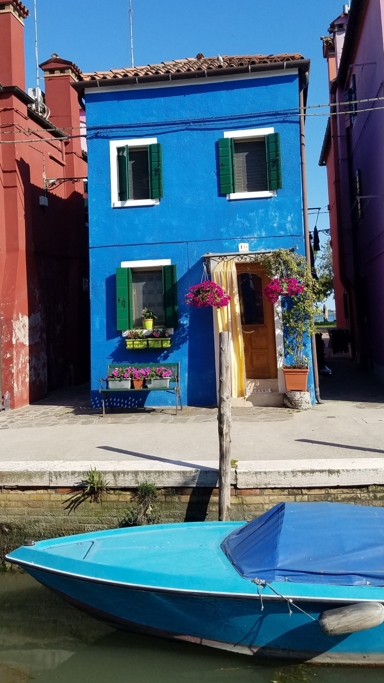 Blue building and blue boat in Burano