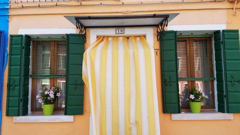Yellow building in Burano, Italy