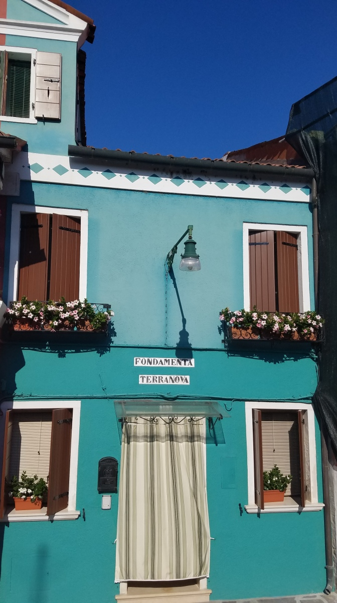 Teal building in Burano, Italy