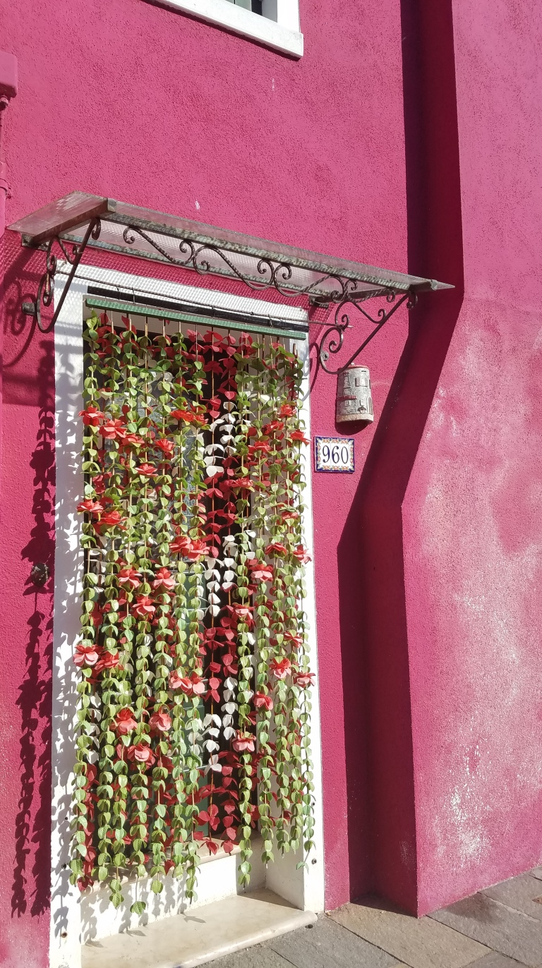 Pink building in Burano, Italy