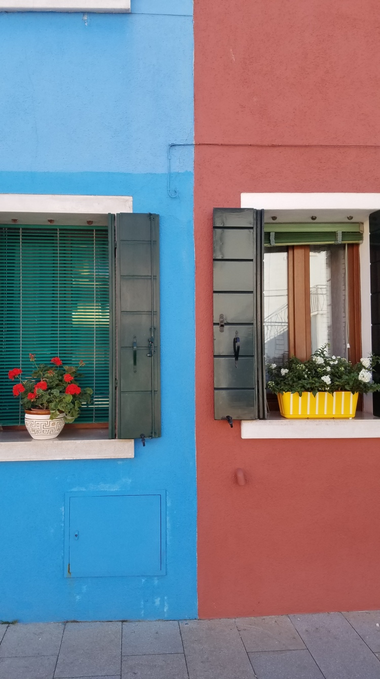 Blue and rust buildings in Burano Italy