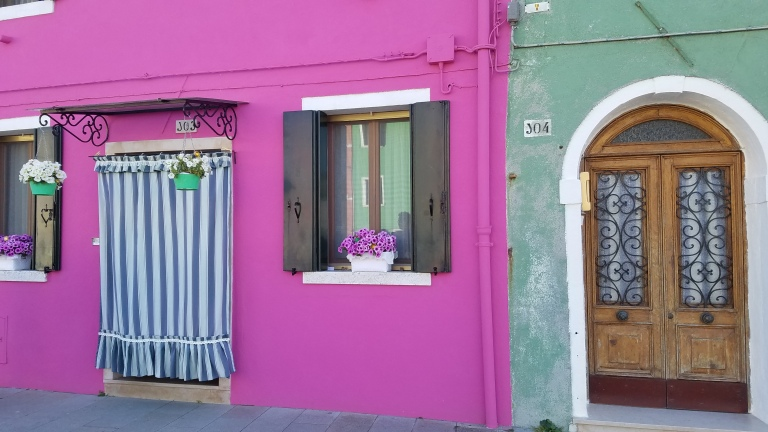 Pink and green building in Burano, Italy